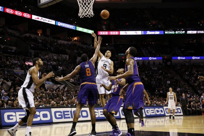 Nov 6, 2013; San Antonio, TX, USA; San Antonio Spurs guard Tony Parker (9) takes a shot over Phoenix Suns forward Channing Frye (8) during the first half at AT&T Center. Mandatory Credit: Soobum Im-USA TODAY Sports
