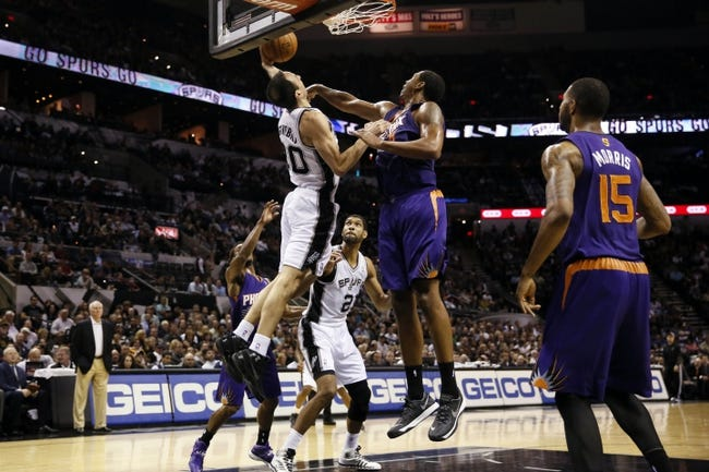 Nov 6, 2013; San Antonio, TX, USA; San Antonio Spurs guard Manu Ginobili (20) drives to the basket as Phoenix Suns forward Channing Frye (right) defends during the first half at AT&T Center. Mandatory Credit: Soobum Im-USA TODAY Sports