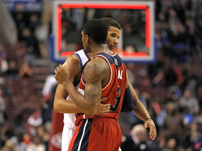 Nov 6, 2013; Philadelphia, PA, USA; Philadelphia 76ers point guard Michael Carter-Williams (1) offers congratulations to Washington Wizards shooting guard Bradley Beal (3) after the game at Wells Fargo Center. The Wizards defeated the 76ers, 116-102. Mandatory Credit: Eric Hartline-USA TODAY Sports