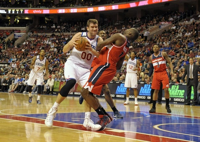 Nov 6, 2013; Philadelphia, PA, USA; Philadelphia 76ers center Spencer Hawes (00) is called for a charging foul against Washington Wizards small forward Martell Webster (9) during the second half at Wells Fargo Center. The Wizards defeated the 76ers, 116-102. Mandatory Credit: Eric Hartline-USA TODAY Sports