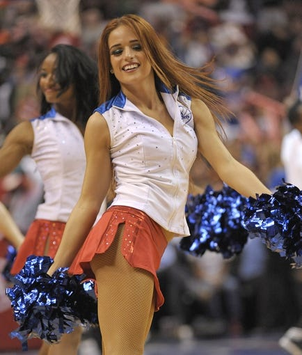 Nov 6, 2013; Philadelphia, PA, USA; Philadelphia 76ers dancer performs during a time out against the Washington Wizards during the second half at Wells Fargo Center. The Wizards defeated the 76ers, 116-102. Mandatory Credit: Eric Hartline-USA TODAY Sports
