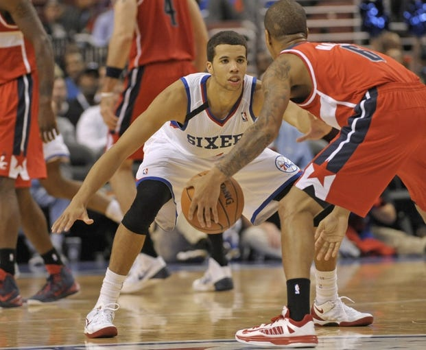 Nov 6, 2013; Philadelphia, PA, USA; Philadelphia 76ers point guard Michael Carter-Williams (1) defends against Washington Wizards point guard Eric Maynor (6) during the second half at Wells Fargo Center. The Wizards defeated the 76ers, 116-102. Mandatory Credit: Eric Hartline-USA TODAY Sports