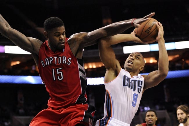 Nov 6, 2013; Charlotte, NC, USA; Charlotte Bobcats guard Gerald Henderson (9) shoots as he is guarded by Toronto Raptors forward Amir Johnson (15) during the game at Time Warner Cable Arena. Bobcats win 92-90. Mandatory Credit: Sam Sharpe-USA TODAY Sports
