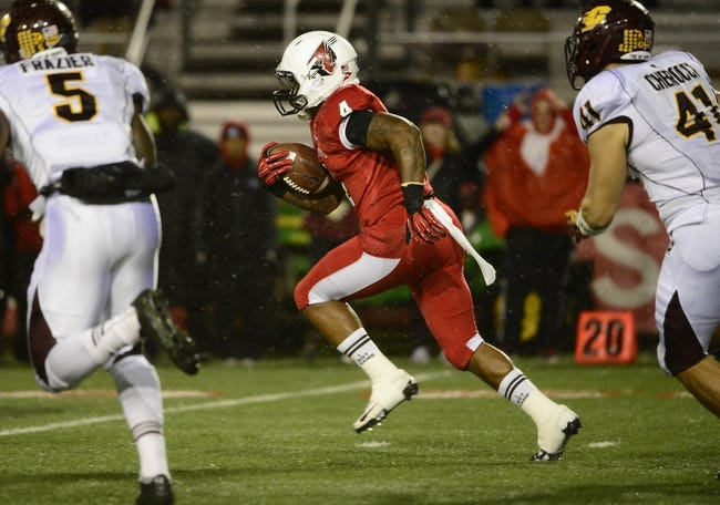 Nov 6, 2013; Muncie, IN, USA; Ball State Cardinals running back Horactio Banks (4) runs the ball against the Central Michigan Chippewas at Scheumann  Stadium. Mandatory Credit: Marc Lebryk-USA TODAY Sports