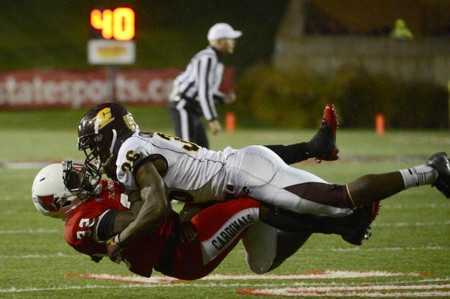 Nov 6, 2013; Muncie, IN, USA; Ball State Cardinals running back Jahwan Edwards (32) is tackled by Central Michigan Chippewas defensive back Avery Cunningham (36) during the first half of the game  at Scheumann  Stadium. Mandatory Credit: Marc Lebryk-USA TODAY Sports