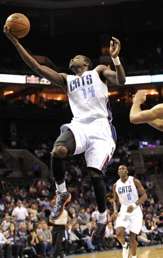 Nov 6, 2013; Charlotte, NC, USA; Charlotte Bobcats forward Michael Kidd-Gilchrist (14) drives to the basket and scores during the game against the Toronto Raptors at Time Warner Cable Arena. Bobcats win 92-90. Mandatory Credit: Sam Sharpe-USA TODAY Sports