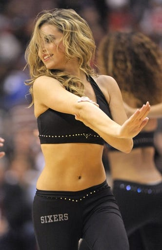 Nov 6, 2013; Philadelphia, PA, USA; Philadelphia 76ers dancers perform during a timeout against the Washington Wizards in the second half at Wells Fargo Center. The Wizards defeated the 76ers, 116-102. Mandatory Credit: Eric Hartline-USA TODAY Sports