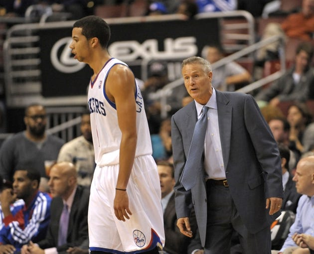 Nov 6, 2013; Philadelphia, PA, USA; Philadelphia 76ers head coach Brett Brown speaks to point guard Michael Carter-Williams (1) against the Washington Wizards during the second half at Wells Fargo Center. The Wizards defeated the 76ers, 116-102. Mandatory Credit: Eric Hartline-USA TODAY Sports