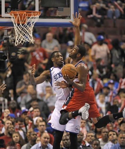 Nov 6, 2013; Philadelphia, PA, USA; Washington Wizards point guard John Wall (2) drives to the basket against Philadelphia 76ers power forward Thaddeus Young (21) during the second half at Wells Fargo Center. The Wizards defeated the 76ers, 116-102. Mandatory Credit: Eric Hartline-USA TODAY Sports