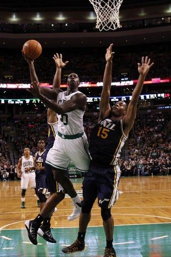 Nov 6, 2013; Boston, MA, USA; Boston Celtics power forward Brandon Bass (30) shoots against Utah Jazz power forward Derrick Favors (15) in the second half at TD Garden. The Celtics defeated the Jazz 97-87. Mandatory Credit: David Butler II-USA TODAY Sports