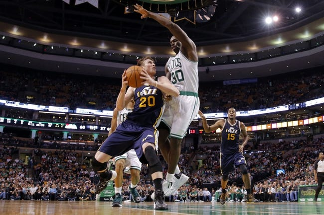 Nov 6, 2013; Boston, MA, USA; Utah Jazz small forward Gordon Hayward (20) drives the ball against Boston Celtics power forward Brandon Bass (30) in the second half at TD Garden. The Celtics defeated the Jazz 97-87. Mandatory Credit: David Butler II-USA TODAY Sports