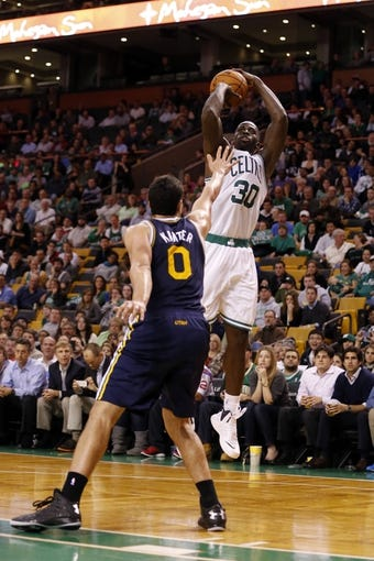 Nov 6, 2013; Boston, MA, USA; Boston Celtics power forward Brandon Bass (30) shoots against Utah Jazz center Enes Kanter (0) in the second half at TD Garden. The Celtics defeated the Jazz 97-87. Mandatory Credit: David Butler II-USA TODAY Sports