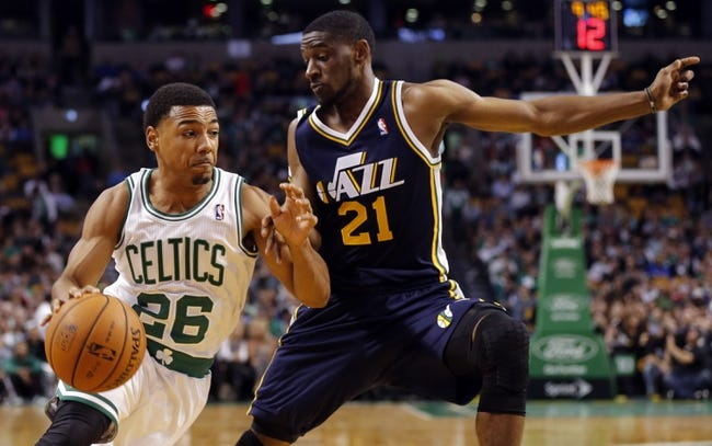 Nov 6, 2013; Boston, MA, USA; Boston Celtics point guard Phil Pressey (26) drives the ball against Utah Jazz shooting guard Ian Clark (21) in the second half at TD Garden. The Celtics defeated the Jazz 97-87. Mandatory Credit: David Butler II-USA TODAY Sports