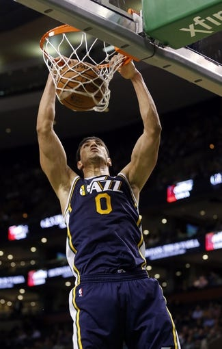 Nov 6, 2013; Boston, MA, USA; Utah Jazz center Enes Kanter (0) makes the basket against the Boston Celtics in the second half at TD Garden. The Celtics defeated the Jazz 97-87. Mandatory Credit: David Butler II-USA TODAY Sports