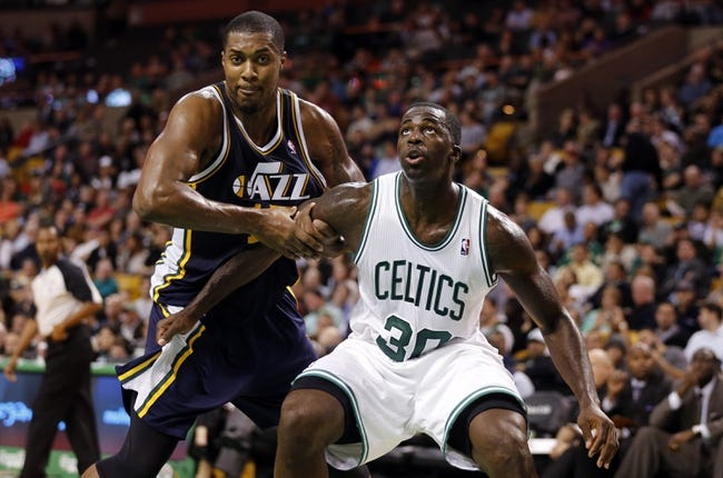 Nov 6, 2013; Boston, MA, USA; Utah Jazz power forward Derrick Favors (15) works for the rebound against Boston Celtics power forward Brandon Bass (30) in the second half at TD Garden. The Celtics defeated the Jazz 97-87. Mandatory Credit: David Butler II-USA TODAY Sports
