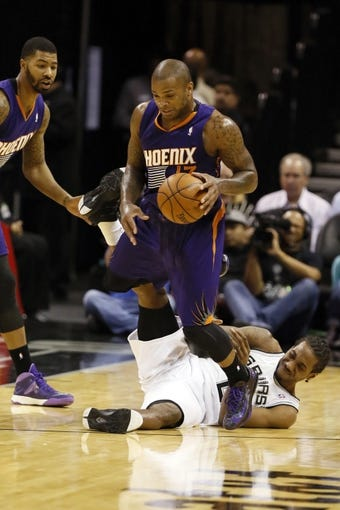 Nov 6, 2013; San Antonio, TX, USA; San Antonio Spurs forward Kawhi Leonard (2) has the ball stolen by Phoenix Suns forward P.J Tucker (17) during the second half at AT&T Center. The Spurs won 99-96. Mandatory Credit: Soobum Im-USA TODAY Sports