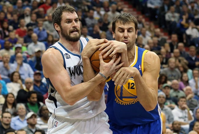 Nov 6, 2013; Minneapolis, MN, USA; Minnesota Timberwolves power forward Kevin Love (42) fights for the ball with Golden State Warriors center Andrew Bogut (12) in the second half at Target Center. The Warriors won 106-93. Mandatory Credit: Jesse Johnson-USA TODAY Sports