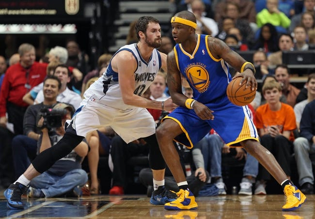 Nov 6, 2013; Minneapolis, MN, USA; Golden State Warriors center Jermaine O'Neal (7) attempts to get around Minnesota Timberwolves power forward Kevin Love (42) in the second half at Target Center. The Warriors won 106-93. Mandatory Credit: Jesse Johnson-USA TODAY Sports