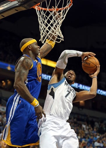 Nov 6, 2013; Minneapolis, MN, USA; Golden State Warriors center Jermaine O'Neal (7) attempts to block a shot by Minnesota Timberwolves power forward Derrick Williams (7) in the second half at Target Center. The Warriors won 106-93. Mandatory Credit: Jesse Johnson-USA TODAY Sports