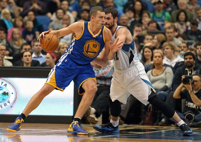 Nov 6, 2013; Minneapolis, MN, USA; Minnesota Timberwolves power forward Kevin Love (42) defends on Golden State Warriors power forward David Lee (10) in the second half at Target Center. The Warriors won 106-93. Mandatory Credit: Jesse Johnson-USA TODAY Sports