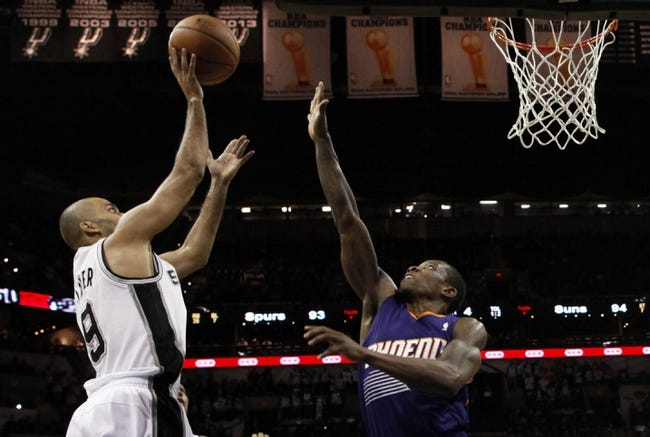 Nov 6, 2013; San Antonio, TX, USA; San Antonio Spurs guard Tony Parker (9) takes a shot over Phoenix Suns guard Eric Bledsoe (2) during the second half at AT&T Center. The Spurs won 99-96. Mandatory Credit: Soobum Im-USA TODAY Sports