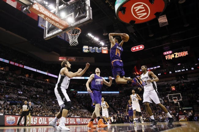 Nov 6, 2013; San Antonio, TX, USA; Phoenix Suns guard Gerald Green (14) dunks during the second half against the San Antonio Spurs at AT&T Center. The Spurs won 99-96. Mandatory Credit: Soobum Im-USA TODAY Sports