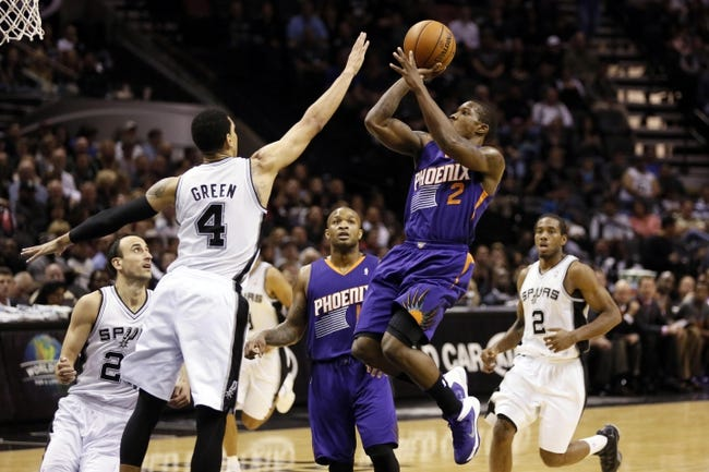 Nov 6, 2013; San Antonio, TX, USA; Phoenix Suns  guard Eric Bledsoe (2) drives to the basket as San Antonio Spurs guard Danny Green (4) defends during the second half at AT&T Center. The Spurs won 99-96. Mandatory Credit: Soobum Im-USA TODAY Sports
