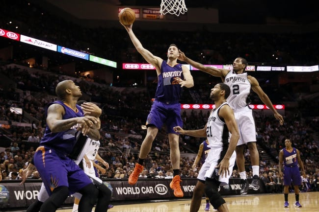 Nov 6, 2013; San Antonio, TX, USA; Phoenix Suns forward Miles Plumlee (22) shoots past San Antonio Spurs forward Kawhi Leonard (2) during the second half at AT&T Center. The Spurs won 99-96. Mandatory Credit: Soobum Im-USA TODAY Sports