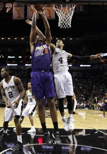 Nov 6, 2013; San Antonio, TX, USA; Phoenix Suns  forward Channing Frye (8) gets fouled while shooting against San Antonio Spurs guard Danny Green (4) during the first half at AT&T Center. Mandatory Credit: Soobum Im-USA TODAY Sports