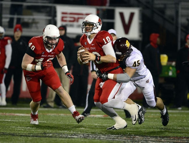 Nov 6, 2013; Muncie, IN, USA; Ball State Cardinals quarterback Keith Wenning (10) is sacked by Central Michigan Chippewas linebacker Joe Ostman (45) during the second half of the game at Scheumann  Stadium. The Ball Sate Cardinals beat Central Michigan Chippewas 44 to 24. Mandatory Credit: Marc Lebryk-USA TODAY Sports