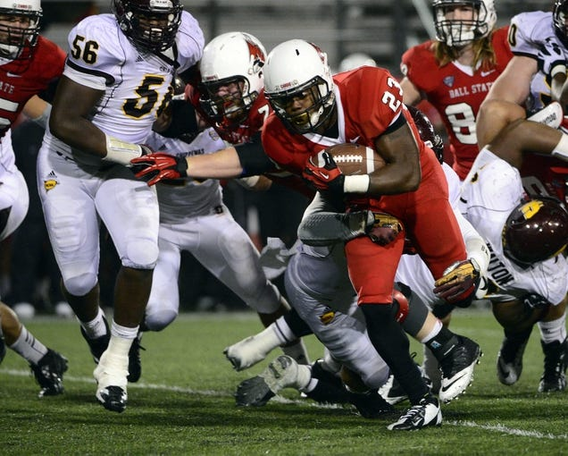 Nov 6, 2013; Muncie, IN, USA; Ball State Cardinals running back Teddy Williamson (23) is tackled by Central Michigan Chippewas linebacker Justin Cherocci (41) during the second half of the game  at Scheumann  Stadium. The Ball Sate Cardinals beat Central Michigan Chippewas 44 to 24. Mandatory Credit: Marc Lebryk-USA TODAY Sports