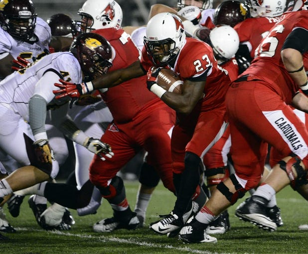 Nov 6, 2013; Muncie, IN, USA; Ball State Cardinals running back Teddy Williamson (23) attempts to run through an opening during the second half of the game  at Scheumann  Stadium. The Ball Sate Cardinals beat Central Michigan Chippewas 44 to 24. Mandatory Credit: Marc Lebryk-USA TODAY Sports