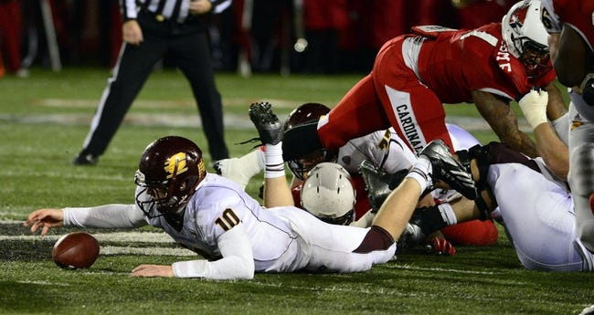 Nov 6, 2013; Muncie, IN, USA;  Central Michigan Chippewas quarterback Cooper Rush (10) scrambles to grab a ball in the first half of the game at Scheumann  Stadium. The Ball Sate Cardinals beat Central Michigan Chippewas 44 to 24. Mandatory Credit: Marc Lebryk-USA TODAY Sports