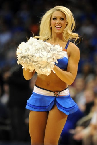 Nov 6, 2013; Oklahoma City, OK, USA; A member of the Oklahoma City Thunder dance team entertains the crowd during a break in action against the Dallas Mavericks at Chesapeake Energy Arena. Mandatory Credit: Mark D. Smith-USA TODAY Sports