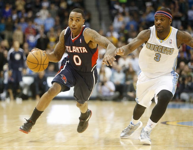 Nov 7, 2013; Denver, CO, USA;  Atlanta Hawks guad Jeff Teague (0) drives to the basket against Denver Nuggets guard Ty Lawson (3) during the second half at Pepsi Center. The Nuggets won 109-107. Mandatory Credit: Chris Humphreys-USA TODAY Sports