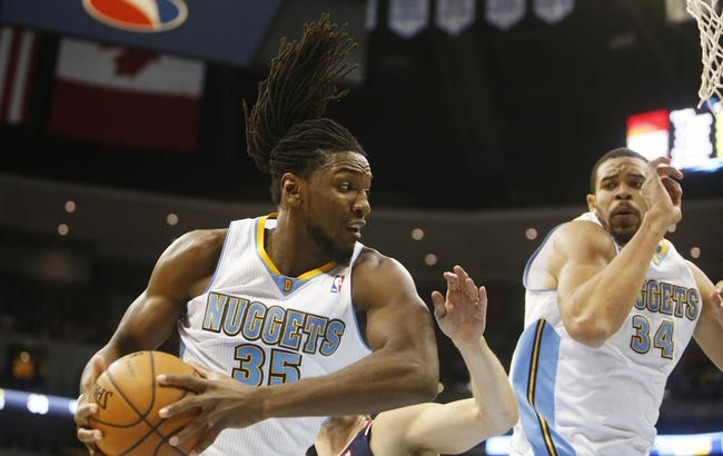 Nov 7, 2013; Denver, CO, USA; Denver Nuggets forward Kenneth Faried (35) rebounds the ball in front of center JaVale McGee (34) during the first half against the Atlanta Hawks at Pepsi Center. Mandatory Credit: Chris Humphreys-USA TODAY Sports