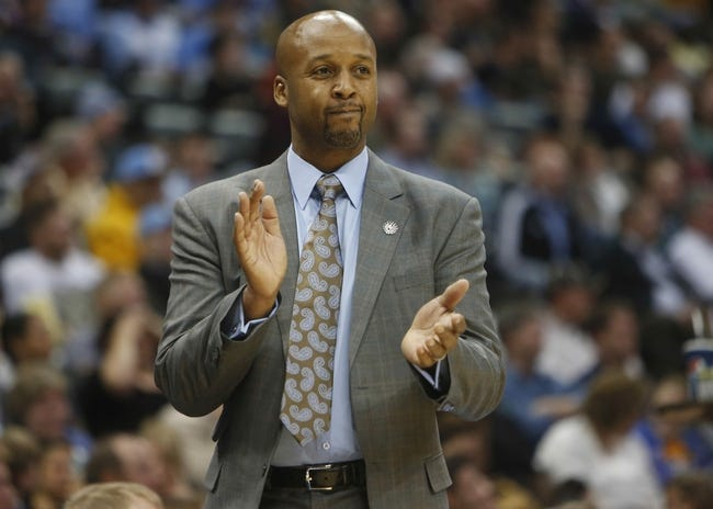 Nov 7, 2013; Denver, CO, USA;  Denver Nuggets head coach Brian Shaw reacts during the second half against the Atlanta Hawks at Pepsi Center. The Nuggets won 109-107. Mandatory Credit: Chris Humphreys-USA TODAY Sports