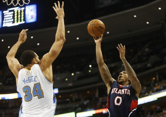 Nov 7, 2013; Denver, CO, USA;  Atlanta Hawks guard Jeff Teague (0) shoots the ball against Denver Nuggets center JaVale McGee (34) during the second half at Pepsi Center. The Nuggets won 109-107. Mandatory Credit: Chris Humphreys-USA TODAY Sports