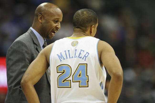 Nov 7, 2013; Denver, CO, USA;  Denver Nuggets head coach Brian Shaw (left) speaks with guard Andre Miller (24) during the second half against the Atlanta Hawks at Pepsi Center. The Nuggets won 109-107. Mandatory Credit: Chris Humphreys-USA TODAY Sports
