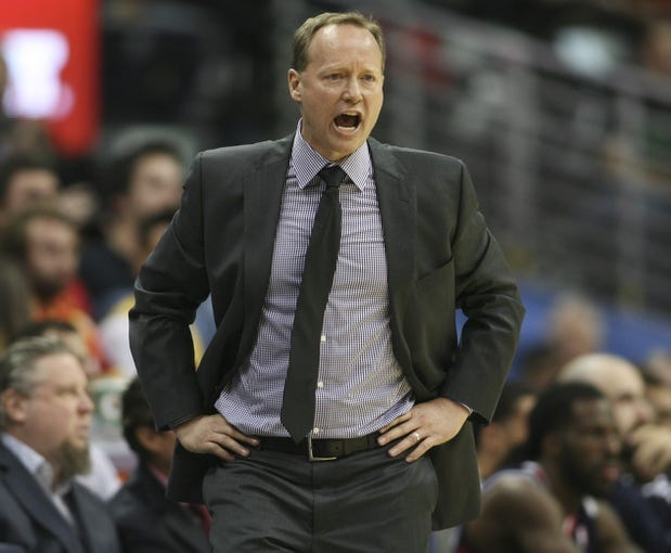 Nov 7, 2013; Denver, CO, USA;  Atlanta Hawks head coach Mike Budenholzer reacts on the sidelines during the second half against the Denver Nuggets at Pepsi Center. The Nuggets won 109-107. Mandatory Credit: Chris Humphreys-USA TODAY Sports
