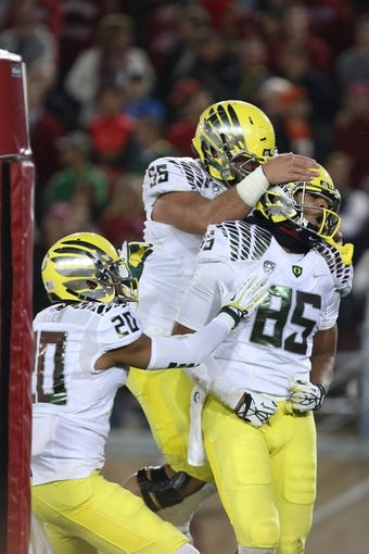 Nov 7, 2013; Stanford, CA, USA; Oregon Ducks teammates celebrate with tight end Pharaoh Brown (85) after scoring a touchdown against the Stanford Cardinal during the fourth quarter at Stanford Stadium. The Stanford Cardinal defeated the Oregon Ducks 26-20. Mandatory Credit: Kelley L Cox-USA TODAY Sports