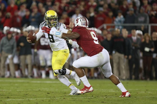 Nov 7, 2013; Stanford, CA, USA; Stanford Cardinal linebacker James Vaughters (9) puts pressure on Oregon Ducks quarterback Marcus Mariota (8) during the fourth quarter at Stanford Stadium. The Stanford Cardinal defeated the Oregon Ducks 26-20. Mandatory Credit: Kelley L Cox-USA TODAY Sports