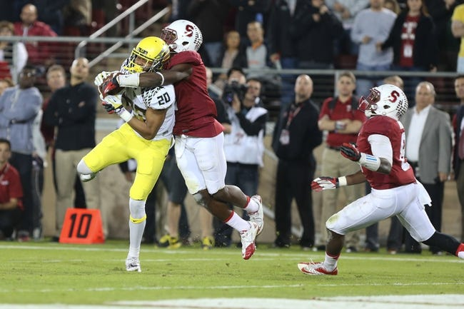 Nov 7, 2013; Stanford, CA, USA; Oregon Ducks wide receiver Chance Allen (20) catches the ball against Stanford Cardinal cornerback Wayne Lyons (2) during the fourth quarter at Stanford Stadium. The Stanford Cardinal defeated the Oregon Ducks 26-20. Mandatory Credit: Kelley L Cox-USA TODAY Sports