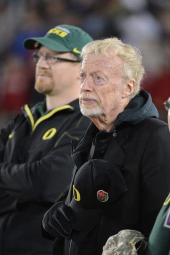 November 7, 2013; Stanford, CA, USA; Nike founder Phil Knight (right) watches from the sideline during the third quarter between the Stanford Cardinal and the Oregon Ducks at Stanford Stadium. Stanford defeated Oregon 26-20. Mandatory Credit: Kyle Terada-USA TODAY Sports