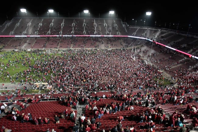 Nov 7, 2013; Stanford, CA, USA; Stanford Cardinal fans rush the field after the win against the Oregon Ducks at Stanford Stadium. The Stanford Cardinal defeated the Oregon Ducks 26-20. Mandatory Credit: Kelley L Cox-USA TODAY Sports