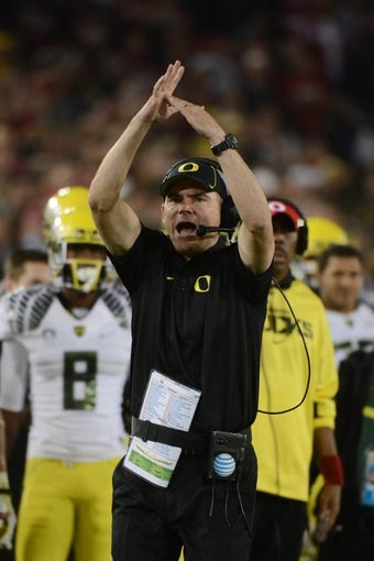 November 7, 2013; Stanford, CA, USA; Oregon Ducks head coach Mark Helfrich calls a timeout during the second quarter against the Stanford Cardinal at Stanford Stadium. Stanford defeated Oregon 26-20. Mandatory Credit: Kyle Terada-USA TODAY Sports
