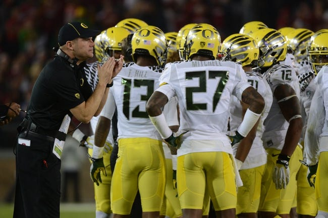 November 7, 2013; Stanford, CA, USA; Oregon Ducks head coach Mark Helfrich claps during the second quarter against the Stanford Cardinal at Stanford Stadium. Mandatory Credit: Kyle Terada-USA TODAY Sports