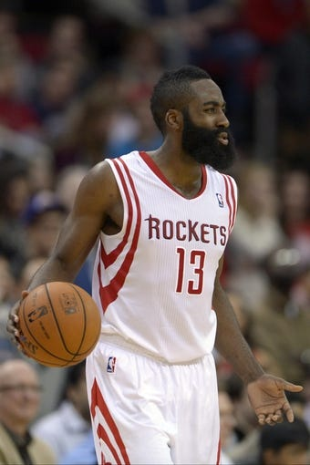 Nov 7, 2013; Houston, TX, USA; Houston Rockets shooting guard James Harden (13) dribbles against the Los Angeles Lakers during the second half at Toyota Center. The Lakers won 99-98. Mandatory Credit: Thomas Campbell-USA TODAY Sports