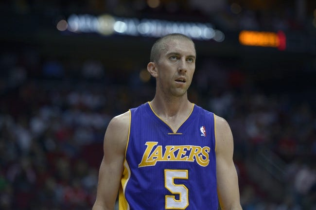 Nov 7, 2013; Houston, TX, USA; Los Angeles Lakers point guard Steve Blake (5) watches a replay against the Houston Rockets during the second half at Toyota Center. The Lakers won 99-98. Mandatory Credit: Thomas Campbell-USA TODAY Sports