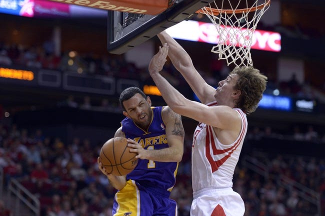 Nov 7, 2013; Houston, TX, USA; Los Angeles Lakers point guard Jordan Farmar (1) drives against Houston Rockets center Omer Asik (3) during the second half at Toyota Center. The Lakers won 99-98. Mandatory Credit: Thomas Campbell-USA TODAY Sports